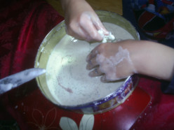 Feel the mixture with hands and add glitter