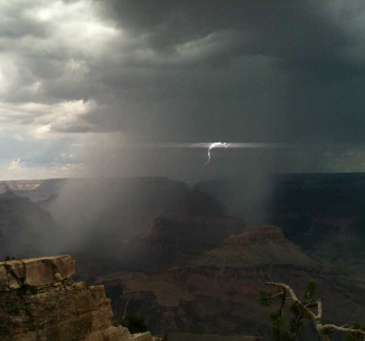 Weather can put a damper on vacation plans in the U.S. and abroad, but trip insurance can help. Rain and lightning prevented us from seeing much of the Grand Canyon when we visited.