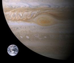 A Voyager photograph of the Great Red Spot on Jupiter with Earth superimposed for comparison.