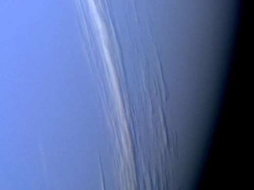 This close-up of the clouds of Neptune snapped by Voyager 2 in 1989 clearly shows how they howl around the planet at supersonic speeds.