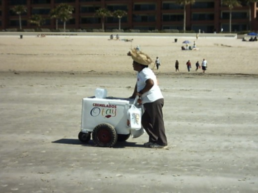 A vendor selling ice cream treats from a pushcart.