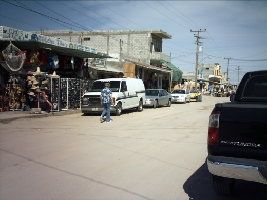 Not far from the beach is this dusty dirt road lined with little shops selling all things Mexican.  The vendors are Mexican, the customers American (along with a few Canadians), the language English and the currency is dollars.