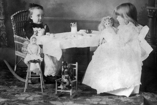 Playing grown-ups is a game that never gets old. Two girls playing grown-ups in the 1890s