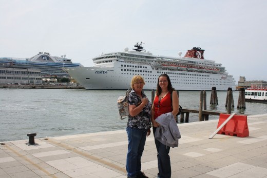My mom and I at the water taxi entrance which is right next to the cruise ships