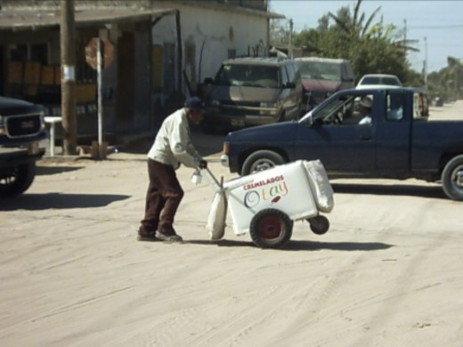 This ice cream vendor serves both the tourists doing their souvenir shopping as well as the children living in the residential streets on either side of the dusty road lined with souvenir shops.