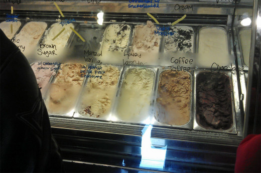 They write the names of the flavors on the display case glass. And, yes, they give you samples.