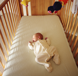 American Academy of Pediatrics  - Baby on firm sleep surface with a fitted crib sheet.