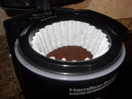 Step 4: Place coffee grounds into filter.