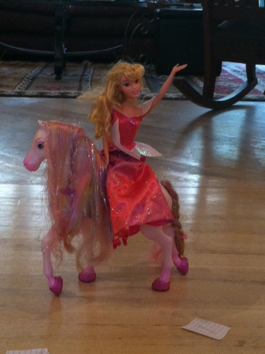 "Piink ""Star Princess"" riding her pink pony and waving at the crowd."