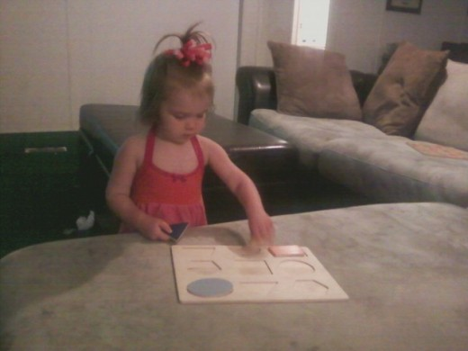 Brooklynn loves wooden puzzles.