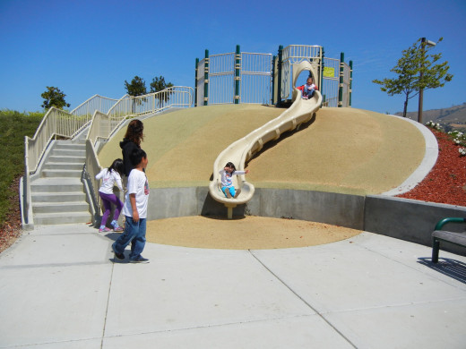 Kids Playing on Slide at A Park