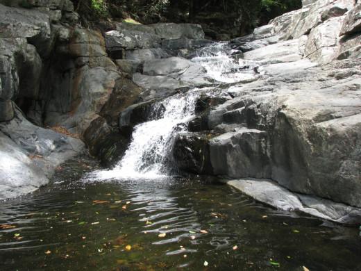 Tiered small waterfalls at the Cedar Creek Falls.