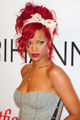Rihanna with Upswept Red Hair and Red Polka-Dot Bow