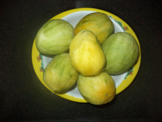 Peeled mangoes ready to be cut into pieces