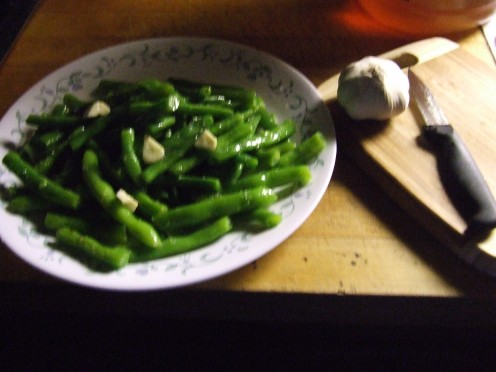 Fresh Green Beans, a clove of sliced garlic, a little olive oil and the salt from your empty bag of pretzels.