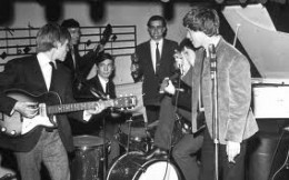 Ian Stewart 'Stu' on stage with the band before Andrew Oldham sent him packing (six plainly did not fit onto the new manager's abacus)