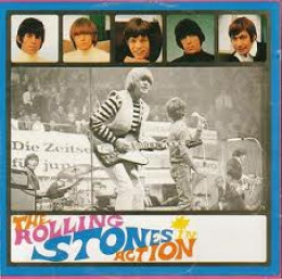 'Rolling Stones in Action', tour recording in Germany features Brian (foreground) on stage with Mick close behind on the mike. Keith only just visible (left) and Bill stage front (right) - Charlie's out of the picture left