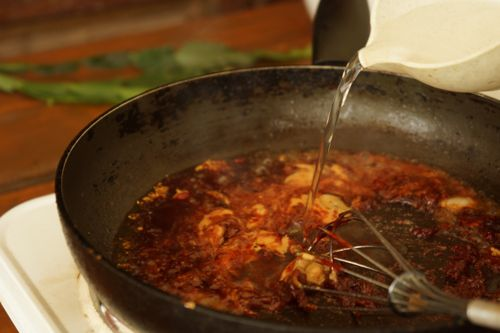 add water to reduce heat/prevent burning and to make the sauce more running