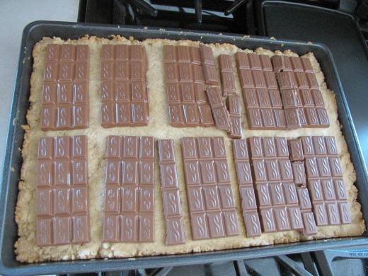 Place chocolate bars on warm baked cookie.