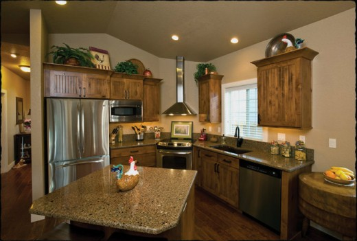 """A kitchen in a Meadow Ranch home featuring quartz countertops. Definitely not what I expected from a """"green"""" home."""