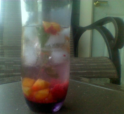 Sitting on the porch and sharing sun tea with fruit and mint is a lovely way to relax on a sunny summer afternoon.