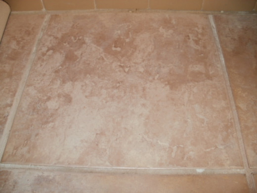 Bathroom tile grout cleaned with baking soda and water.