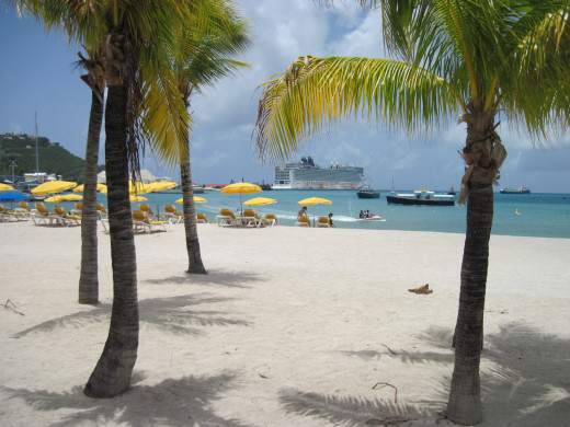 A cruise ship looks prettier when framed by palm trees, and are a reminder of a relaxing day on a tropical beach in St. Maarten.
