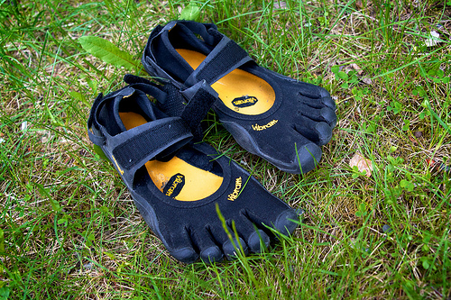 Vibram five fingers simulate the barefoot experience very well.
