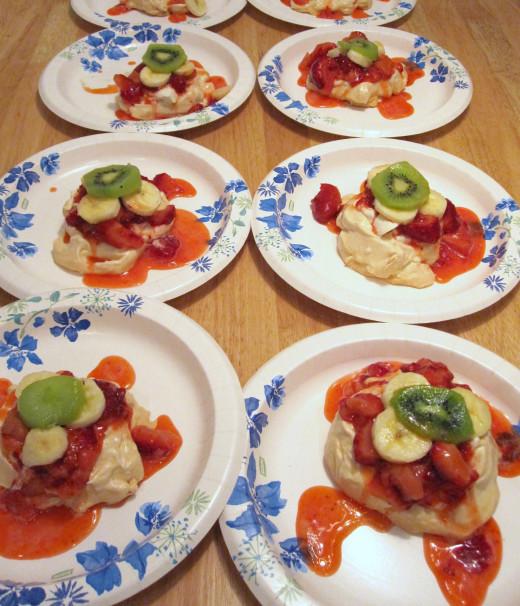 Miniature Pavlovas with strawberries, banana's and kiwi.