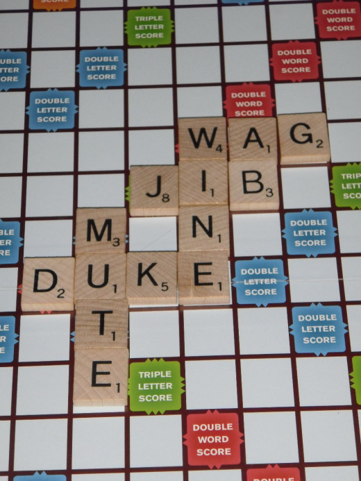 Knowing the Scrabble Official Word List for two-letter words let this player add AG to WINE, and score for AB as well.
