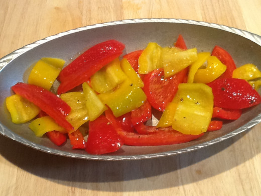 Fresh red and yellow peppers with olive oil, salt and pepper