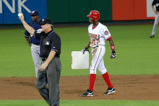 Alfonso Soriano walks off with second base after he joined the 40/40 (40 homers/40 stolen bases) club in 2006.