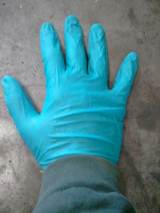 Chemical resistant gloves and long sleeves reduce dermal exposure.