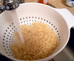 Wash ramen noodles with hot water to make them less fatty