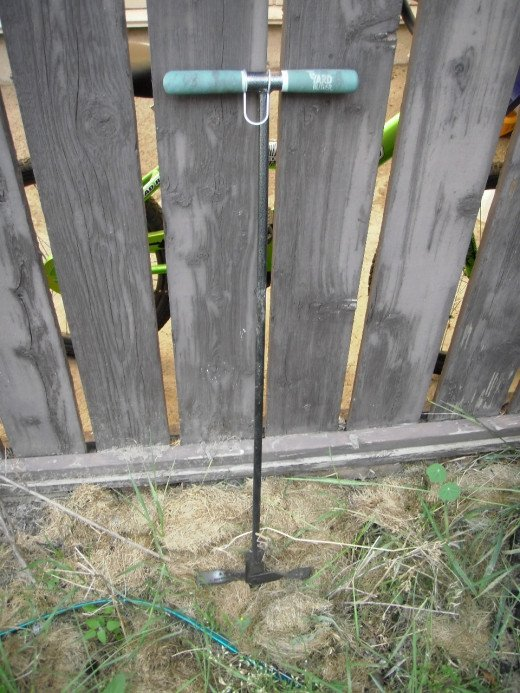 In an organic garden, this compost turning tool with folding flanges at the point is an effective way to aerate compost and speed up the decomposition.