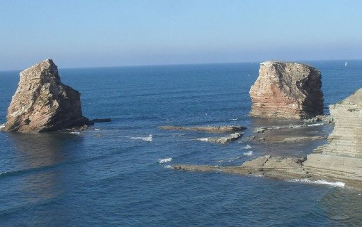 These two high rocks  have been carved out of the cliffs by wave action