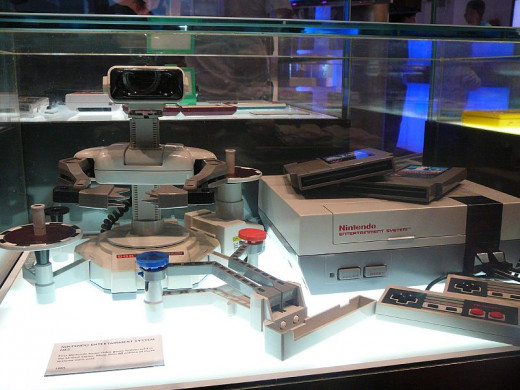 The first Nintendo home video game system sold in the United States, as displayed at the Nintendo World Store in New York City. The system included a Nintendo Entertainment System Control Deck, two NES Controllers, a R.O.B. (Robotic Operating Buddy),