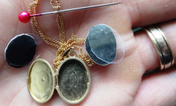 Fitting a photo into a locket.