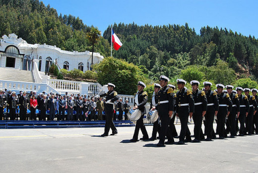An official naval ceremony at the Naval Base. The classic white structure houses the Admiralty.