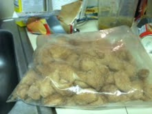 Put the biscuit pieces in a large ziplock bag with white sugar and cinnamon, then shake to cover.