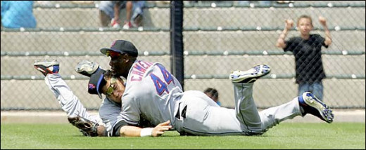 Met outfielders collide. The right fielder use to playing center went for the ball. Serious injuries.