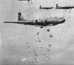 A formation of B-29 Superfortresses performing an area bombing raid.