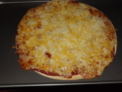 Finished cheese tortilla pizza.