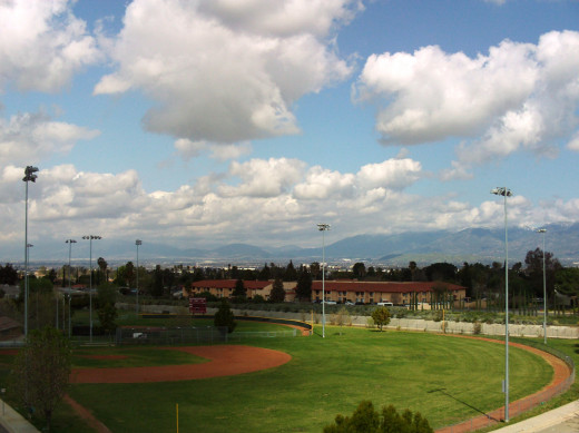 A cloudy day over a baseball field in Southern California.