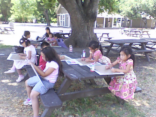 Teaching children to stop and see the beauty around them helps them to look at life in new and different ways. These children are drawing a well at a near-by park.