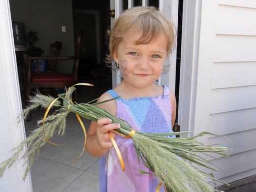 Sweet Little Girl with a Grass Horsie on Lammas