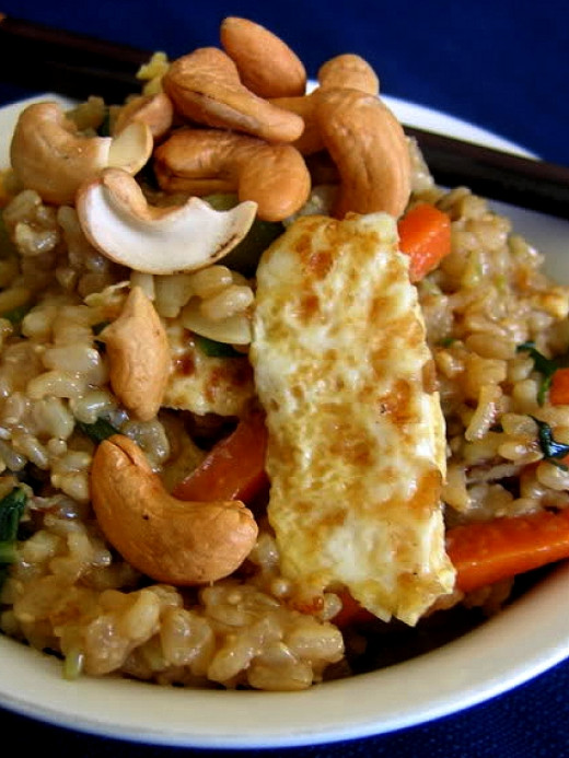 Homemade fried rice can include a huge variety of meats and vegetables that can be healthy choices.