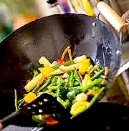 Stir frying the vegetables before adding to the fried rice