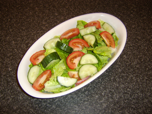 Vegetables are seasoned and combined in serving dish