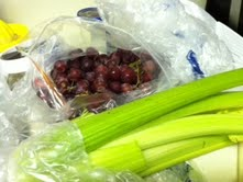 Seedless grapes and celery that will be added to the chicken salad.